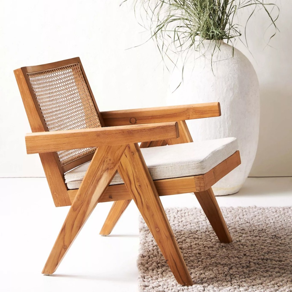 wooden chair with beige seat pad