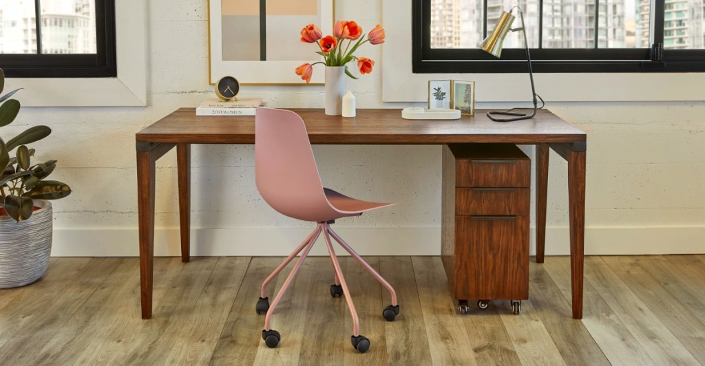 office with wooden desk and pink chair