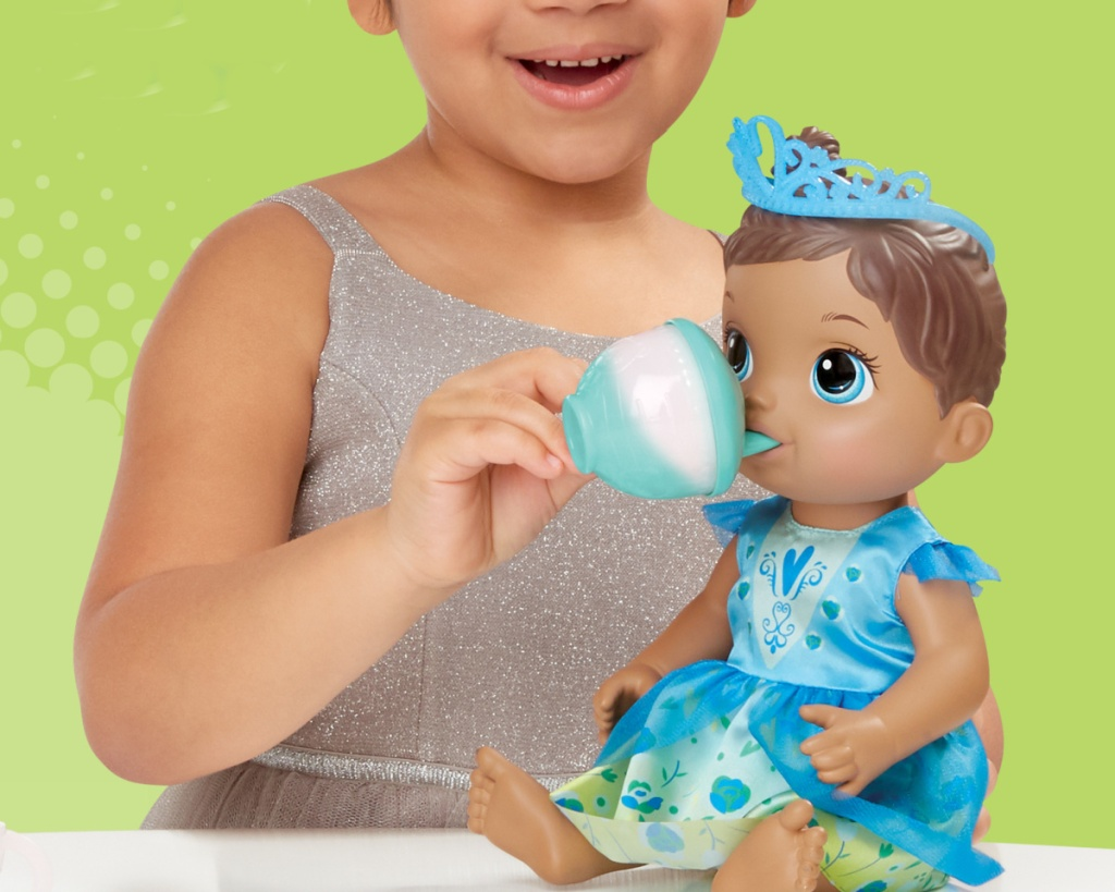 little girl palying with baby alive tea time