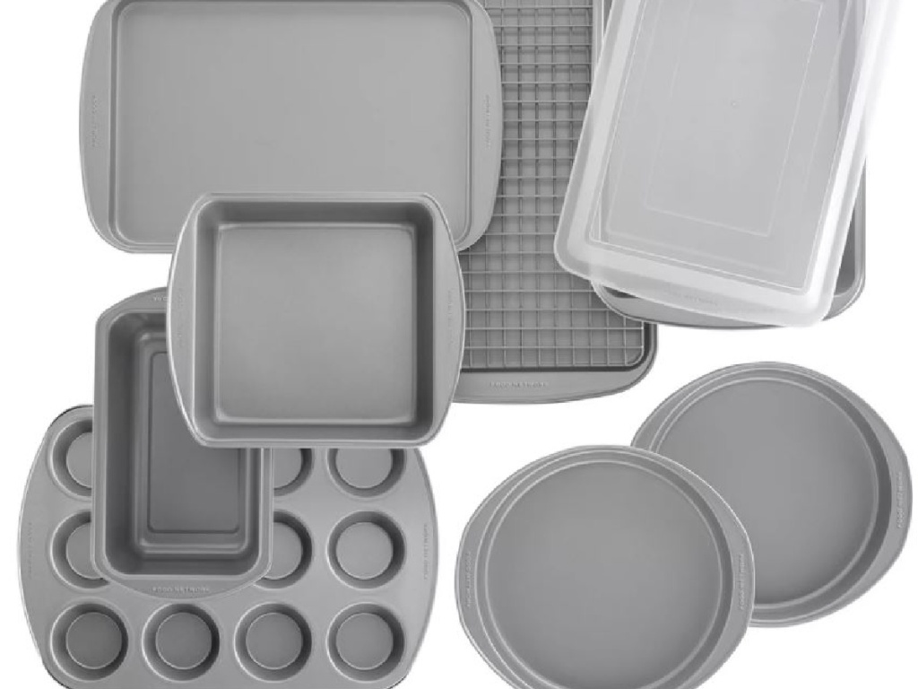 large set of baking pans stacked on each other