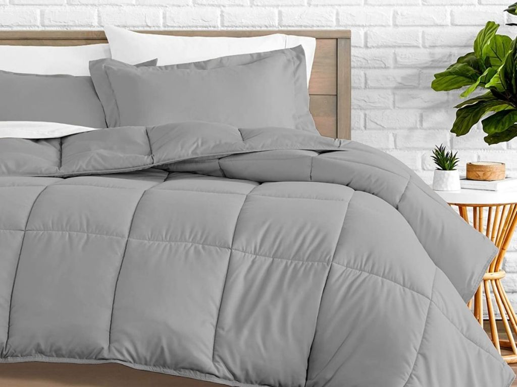 gray comforter set on bed