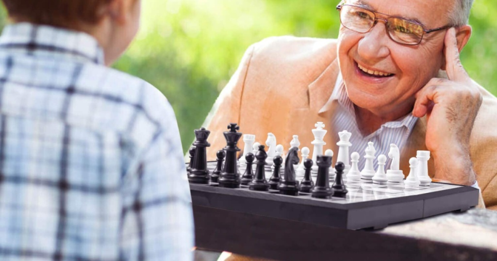 boy and grandpa playing chess