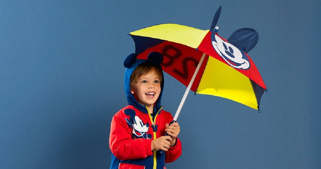 boy holding mickey umbrella