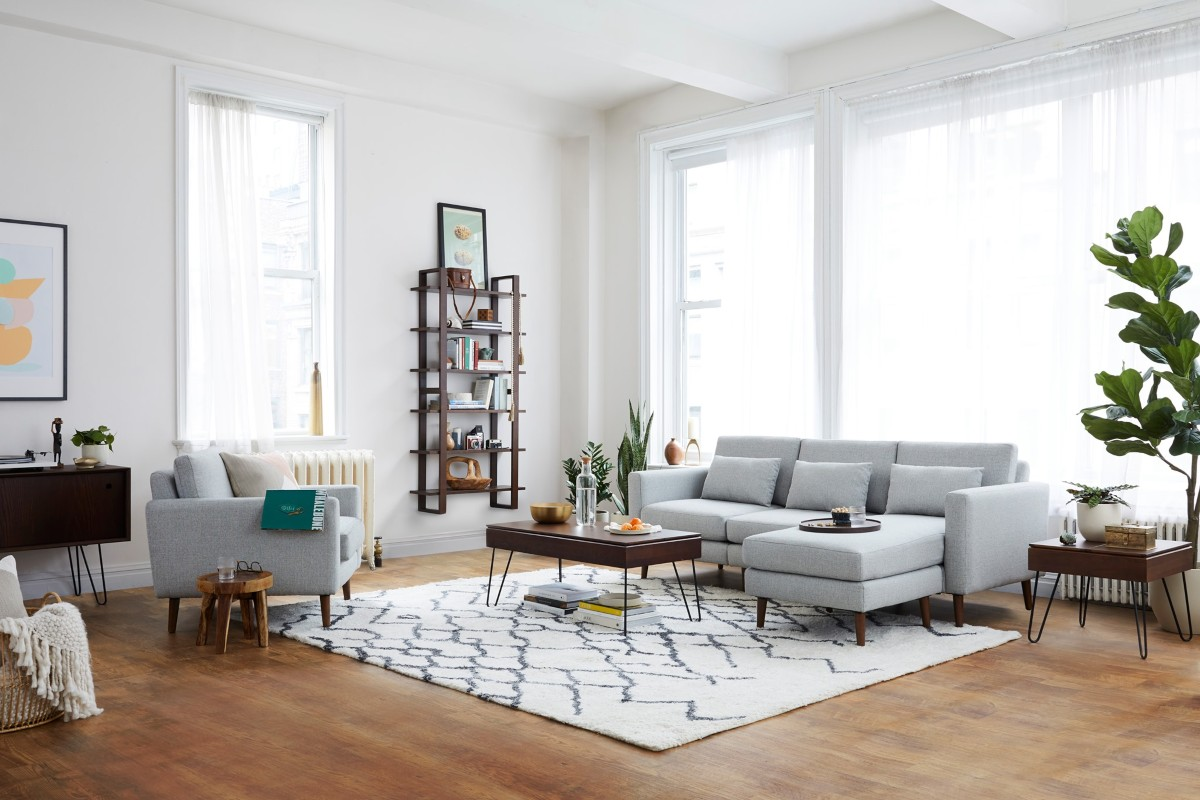 living room with white walls, tall windows, and hardwood flooring