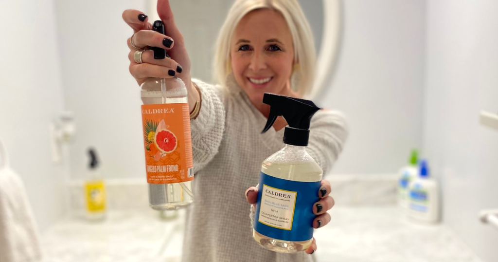 woman holding Caldrea cleaning products