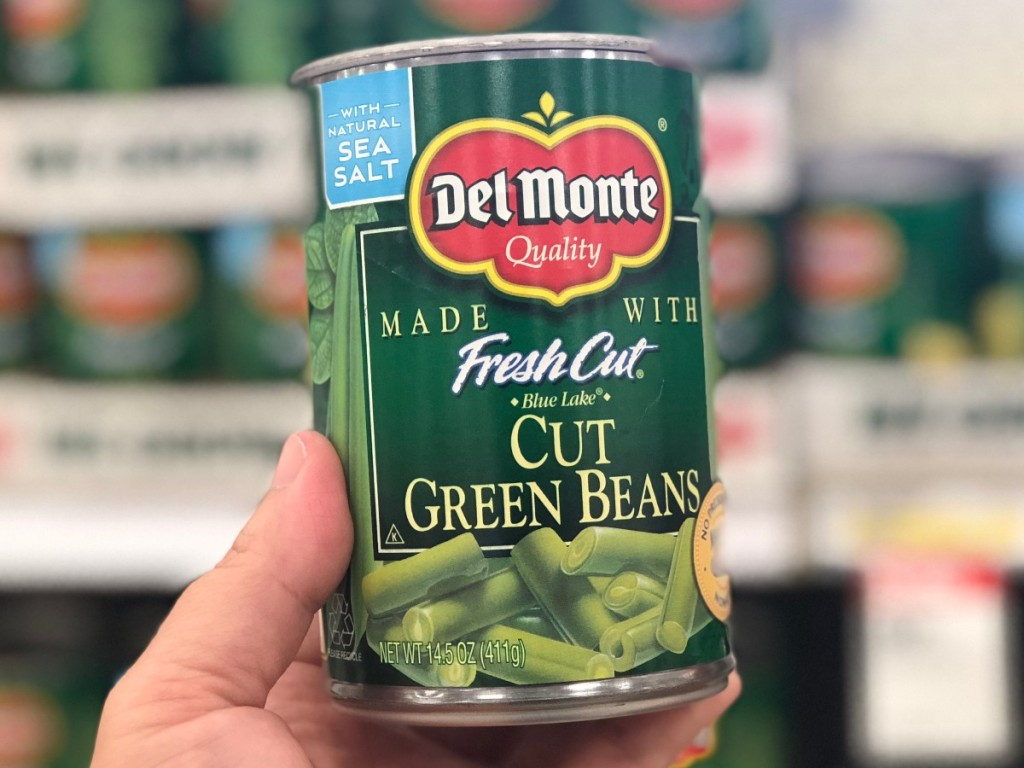 holding a can of green beans