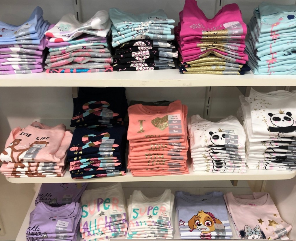 carters girls graphic tees folded in store