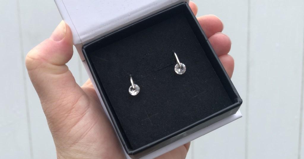 cate & chloe earrings in box in hand