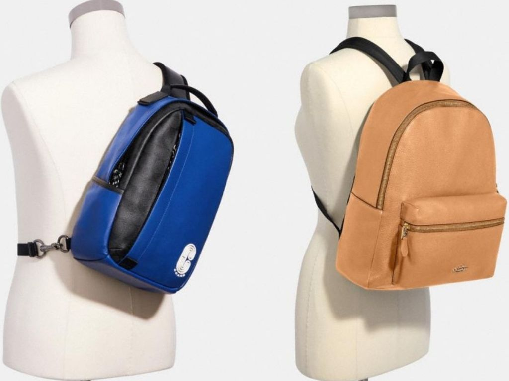 two Coach backpacks on manequins