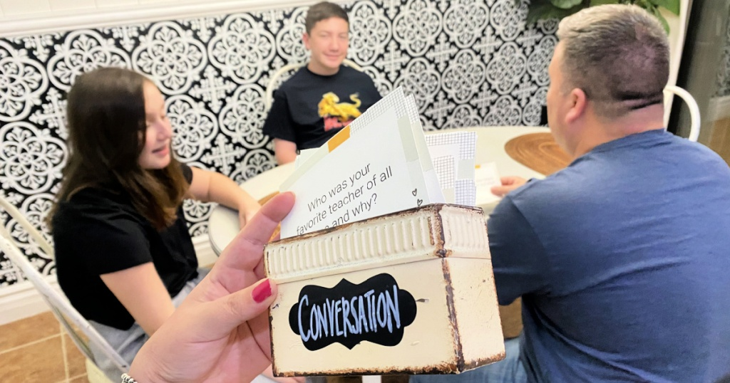 conversation cards in front of a family at the table