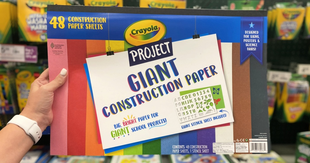 crayola giant construction paper in person's hand