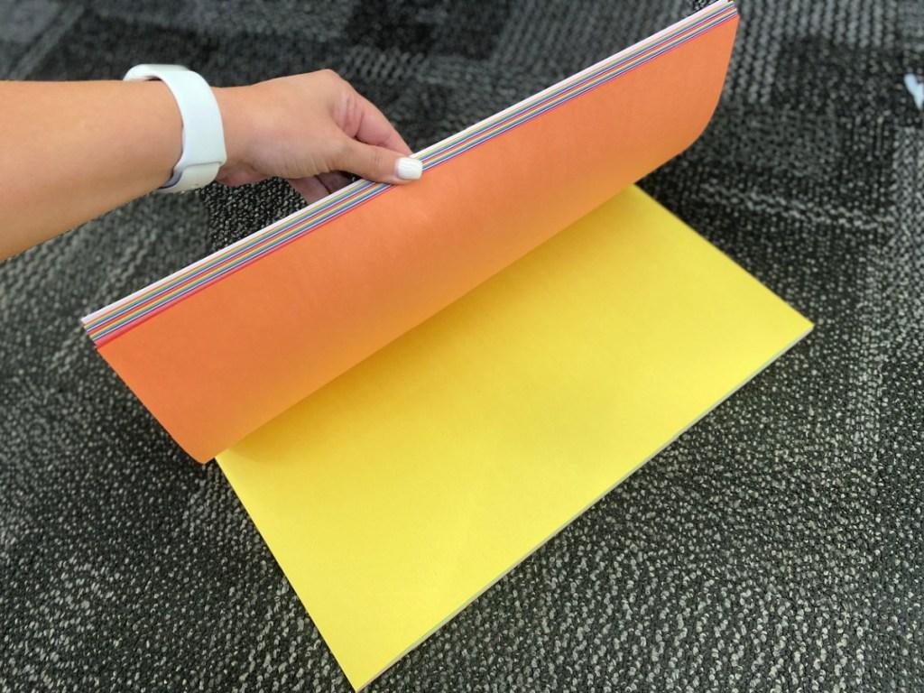 crayola giant construction paper on floor