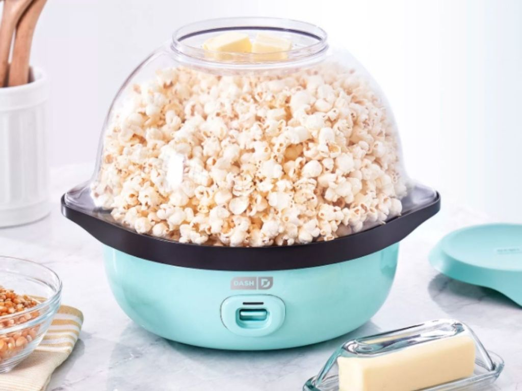 teal Dash popcorn maker on table