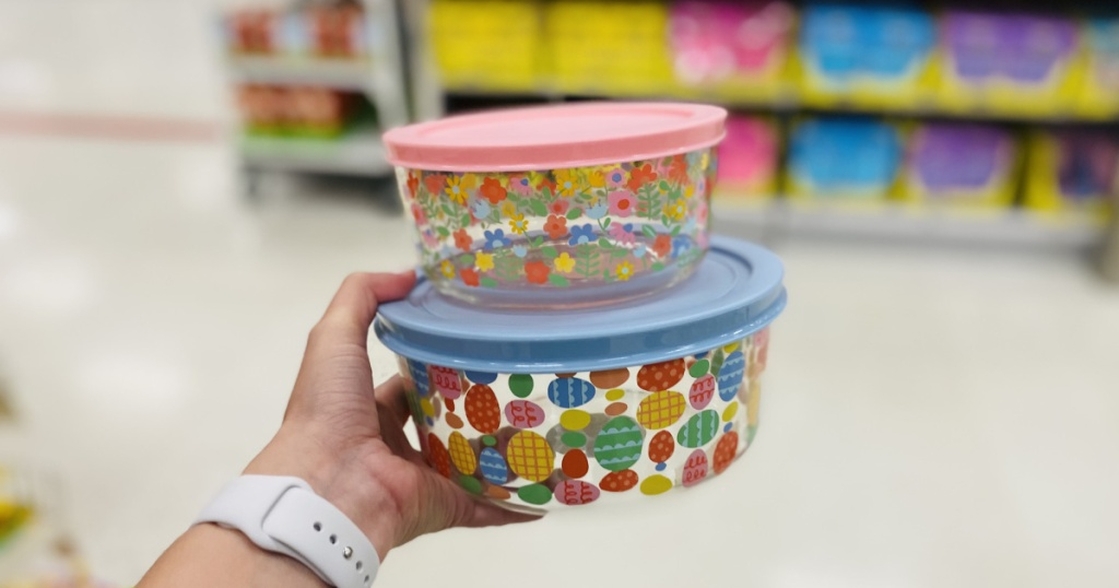 two easter glass tupperware in hand in store at target