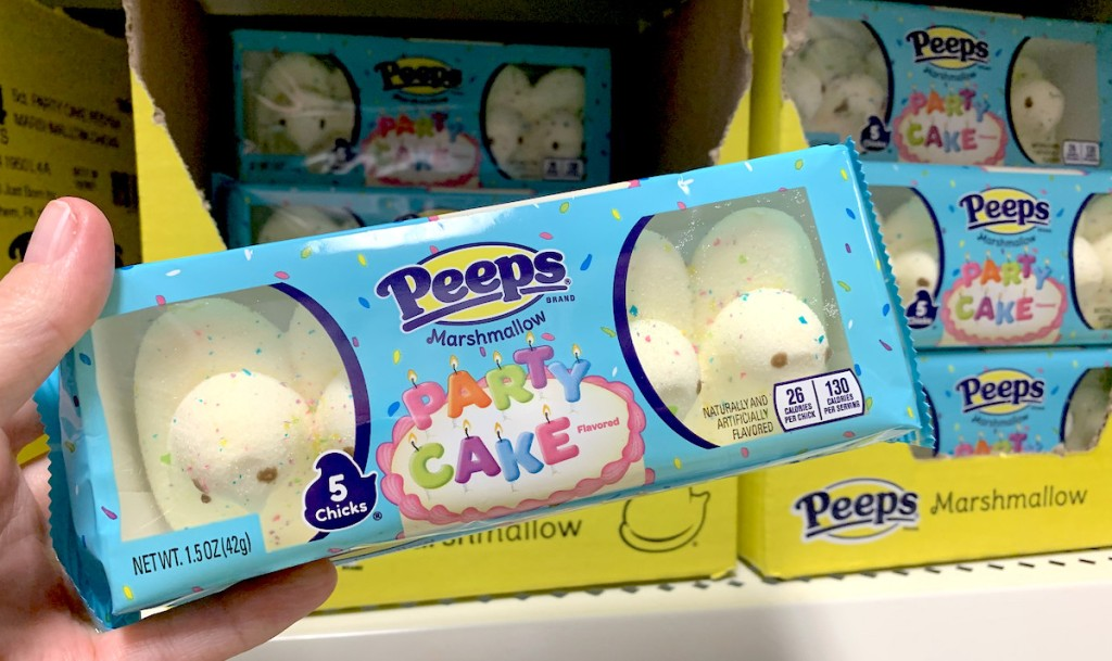 hand holding box of white party cake peeps