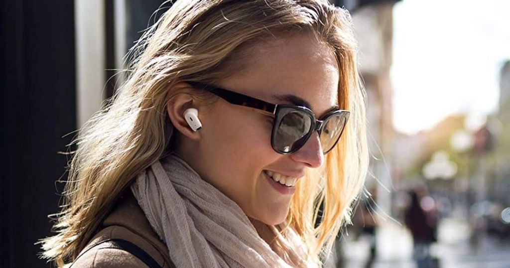 woman wearing sunglasses and white earbuds