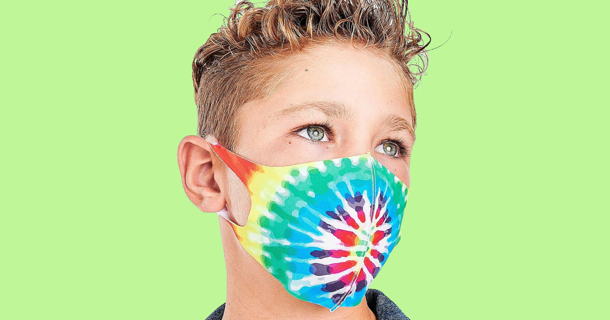 boy wearing tie-dye mask with lime green background
