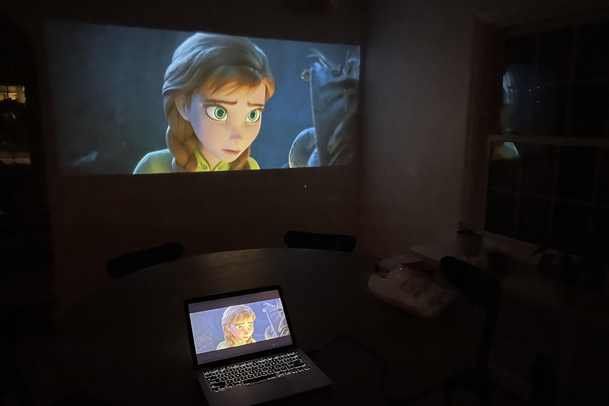 frozen on laptop and projector screen in dark room