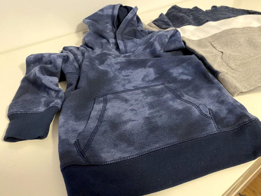 close up of blue walmart garanimals sweatshirt - cheap kids clothes