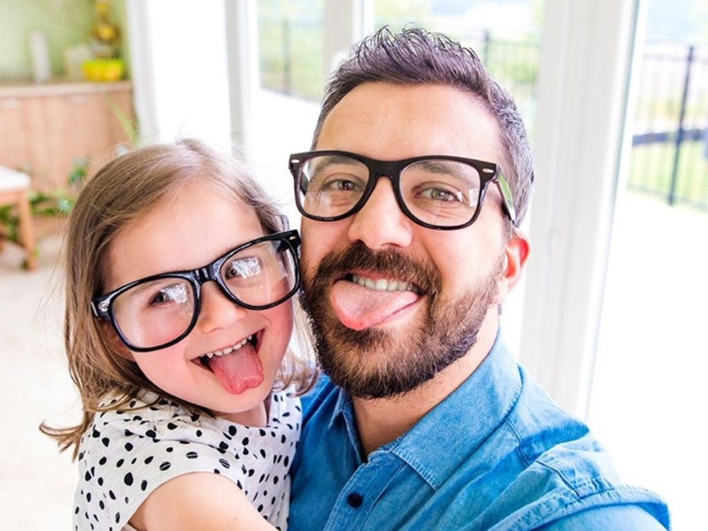 child and parent wearing glasses
