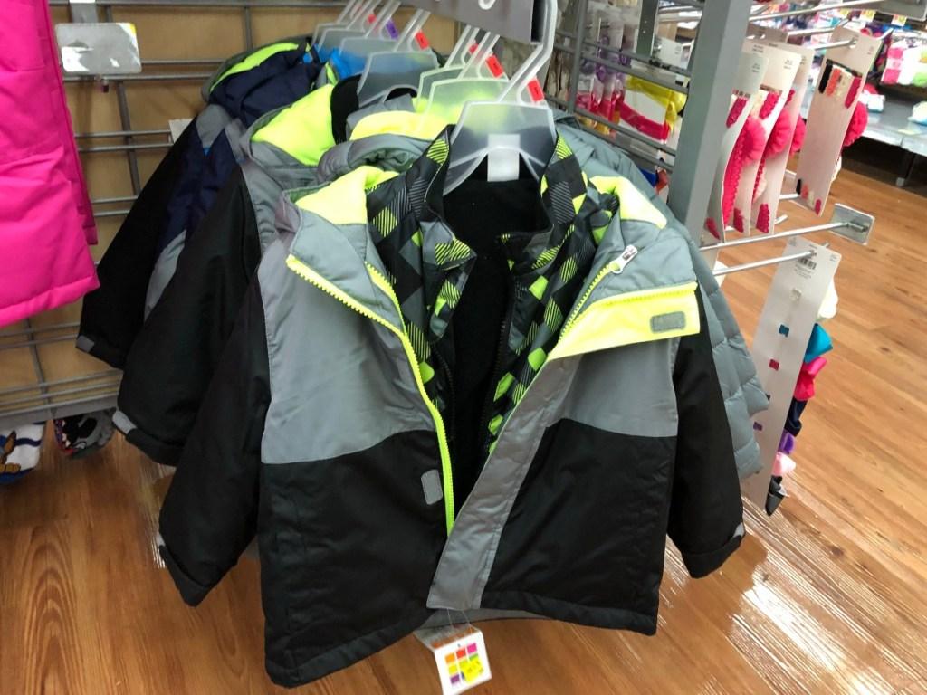 child's coat hanging at Walmart