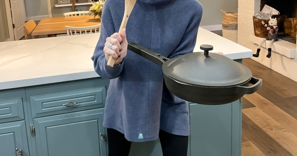 woman holding always pan in kitchen