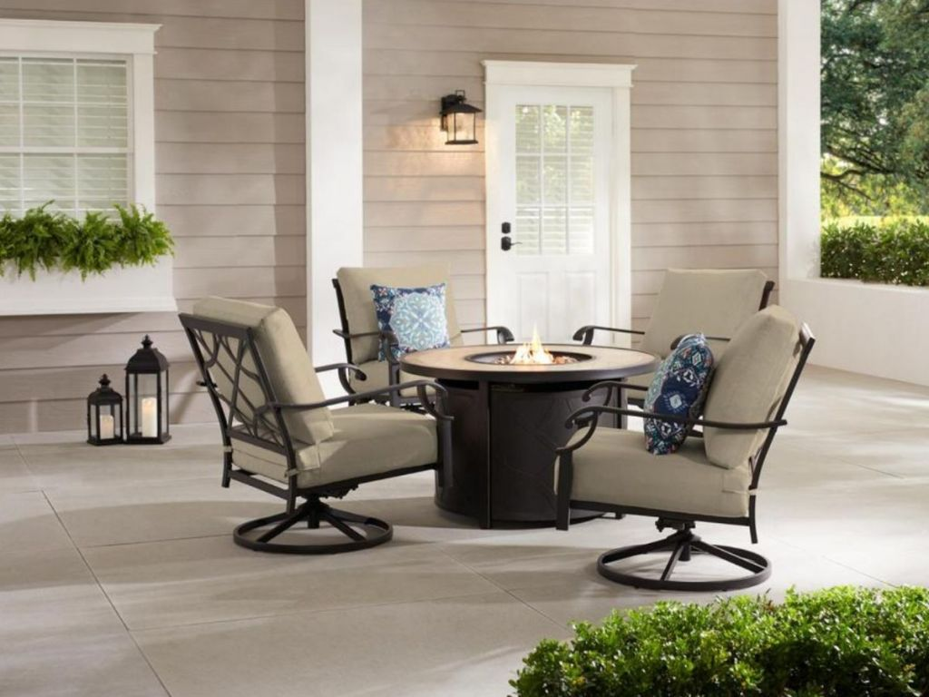 fire pit seating set with tan cushions