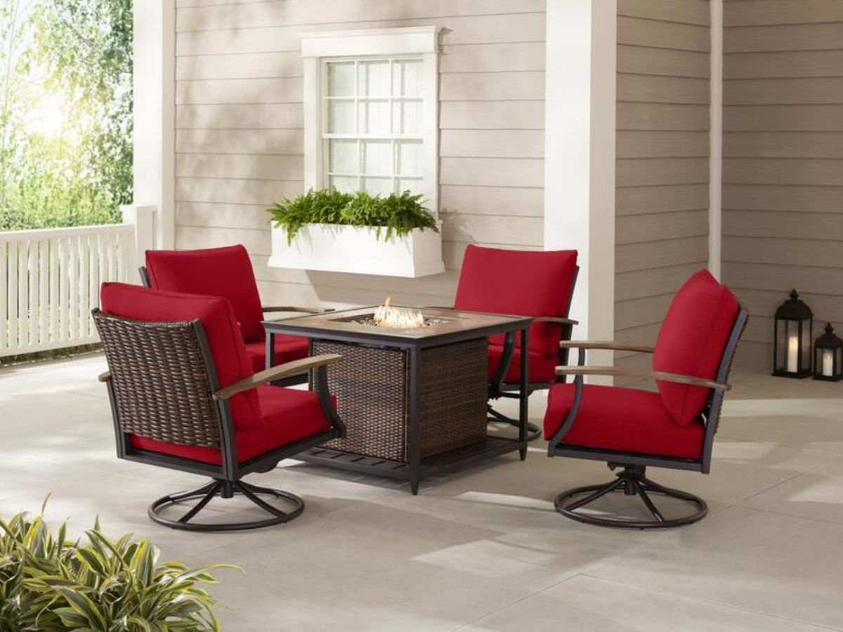 wicket fire pit patio set with red cushions