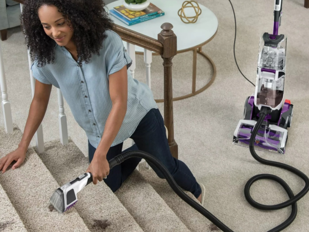 woman cleaning steps with hoover smartwash carpet cleaner