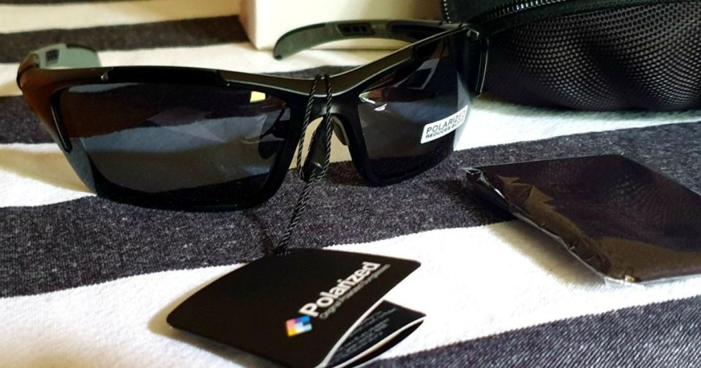 black framed sunglasses with polarized tag hanging off glasses