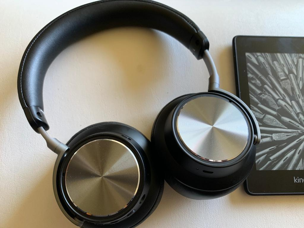 headphones next to a Kindle