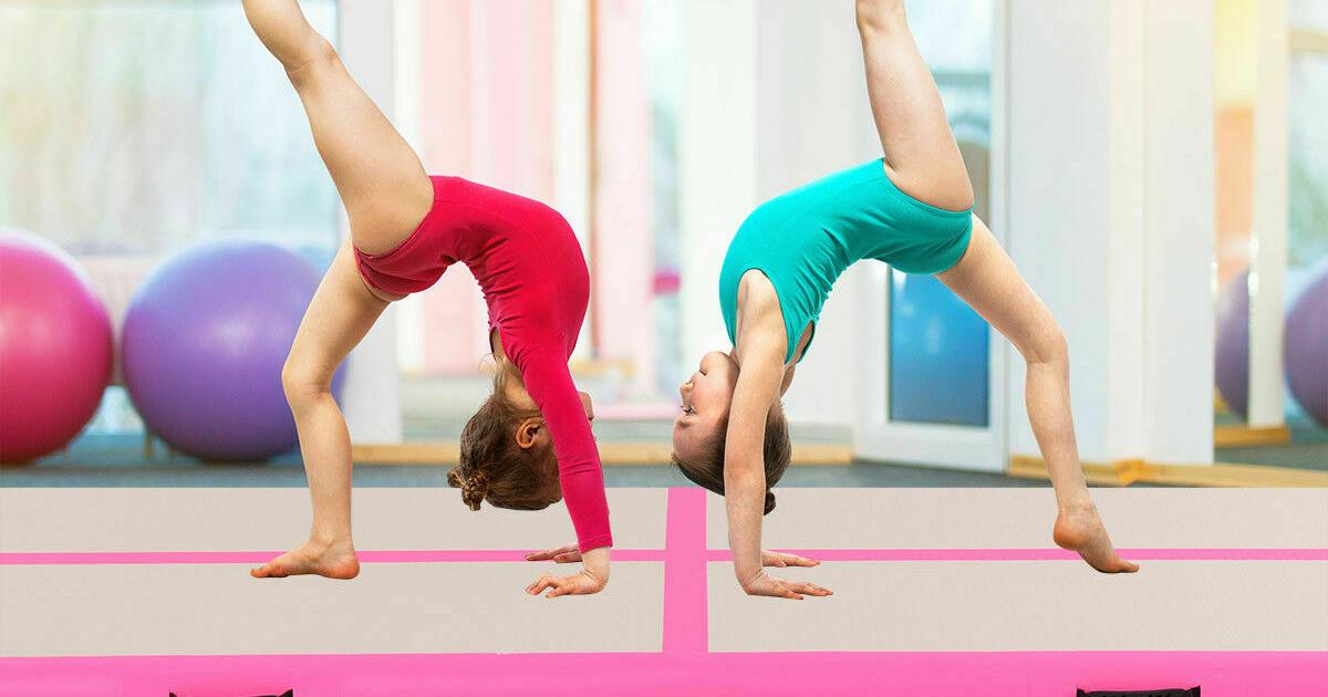 kids doing gymnastics on an inflatable mat