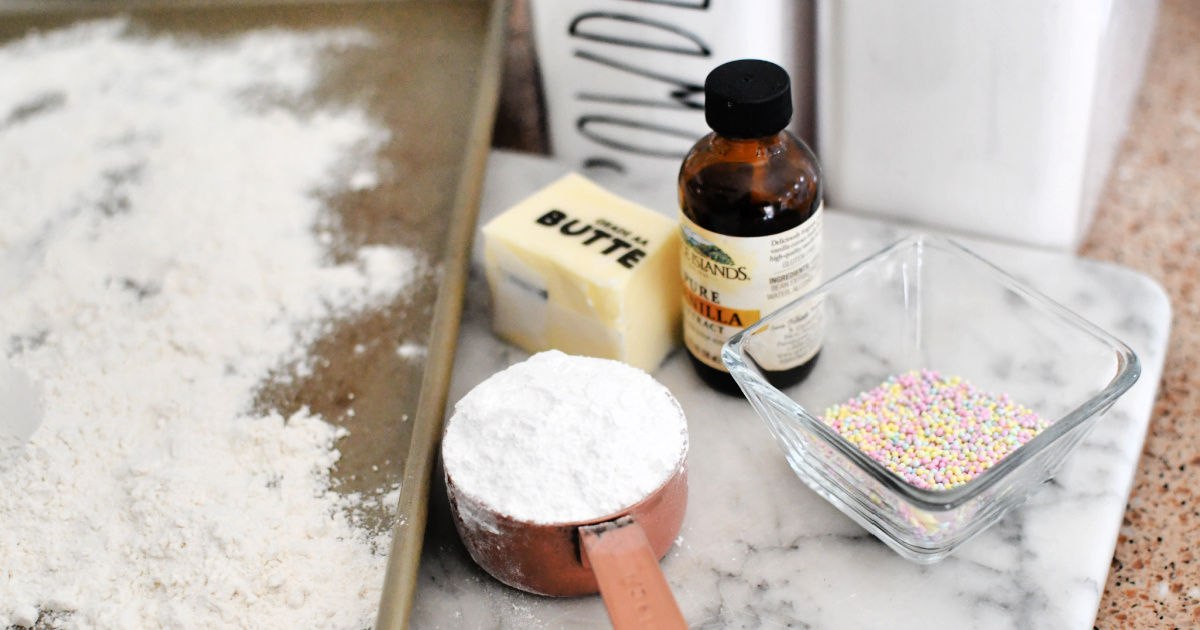 flour, butter, vanilla, and sprinkles on tray