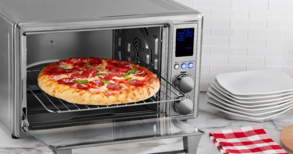 insignia air fryer toaster oven with pizza in it