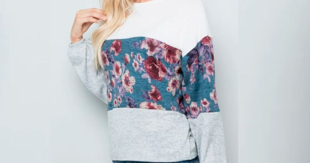 woman in floral color block top