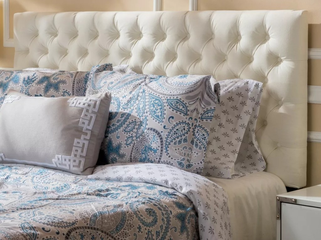 white button-tufted headboard on bed