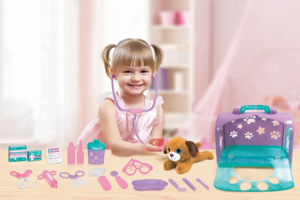 little girl with kid connection vet set