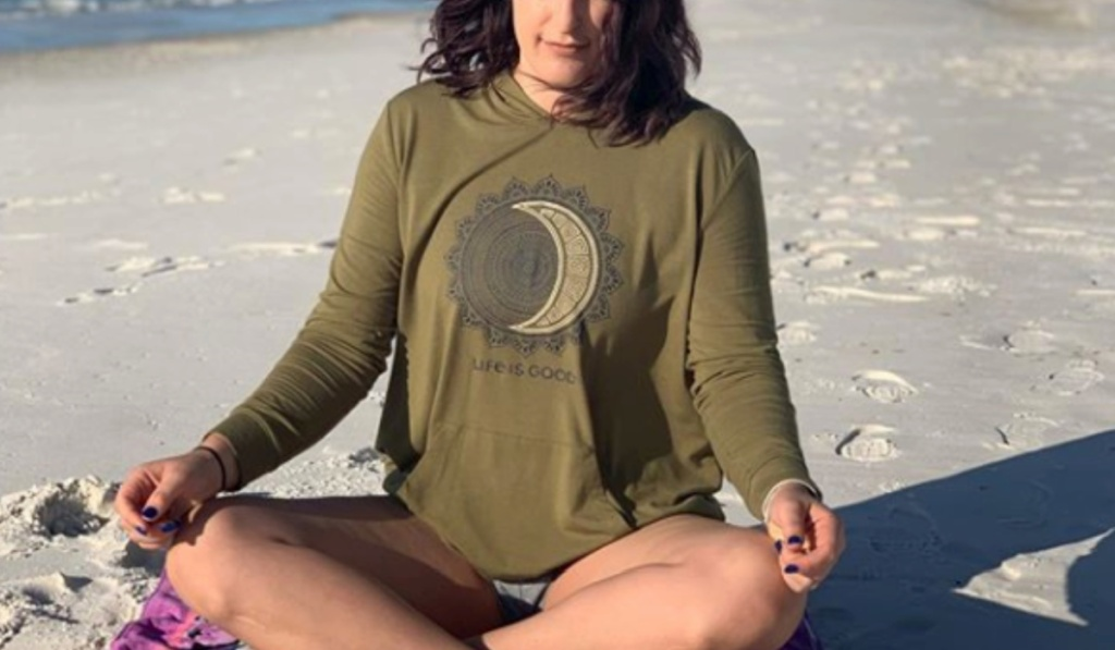 woman sitting on beach doing yoga life is good pullovers