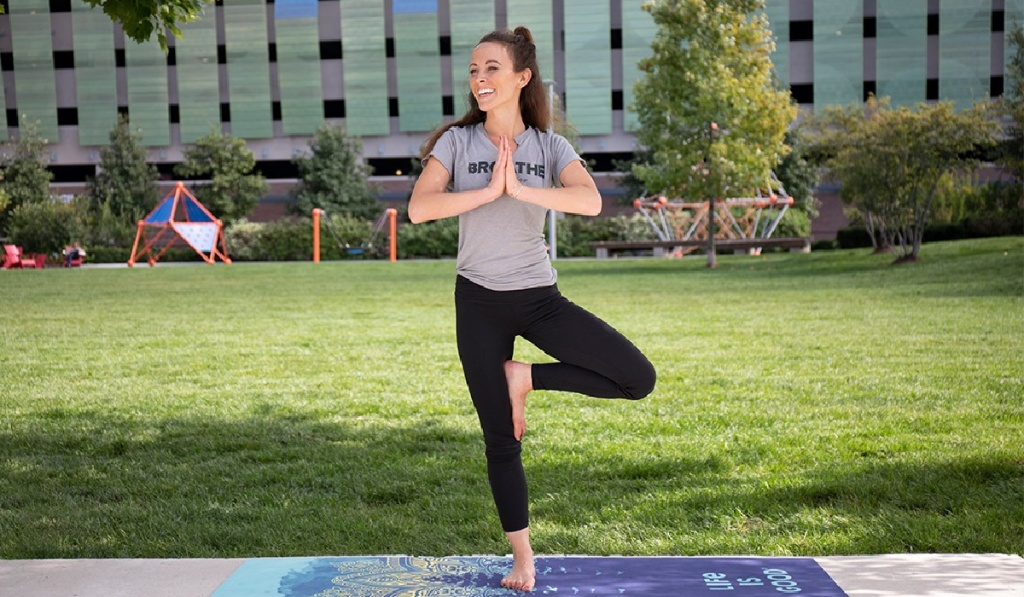 woman doing yoga in park in life is good womens activewear