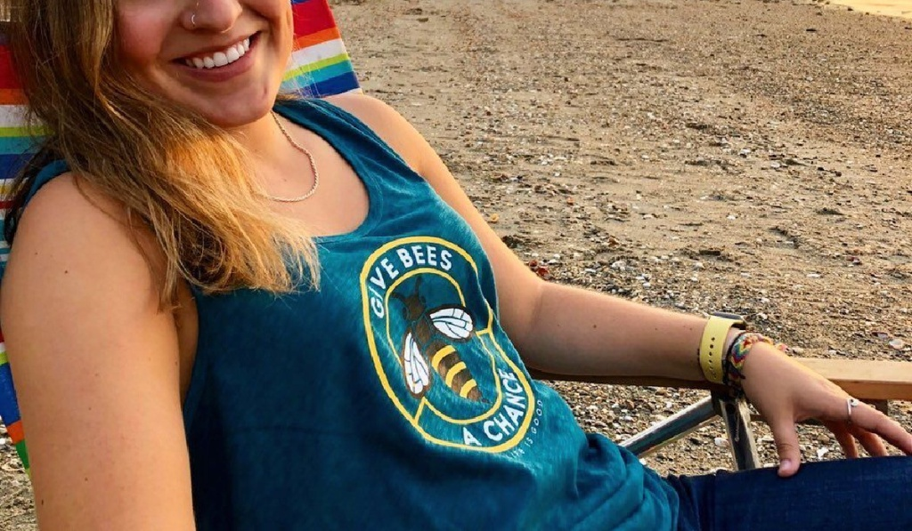 woman sitting on beach with life is good womens tanks