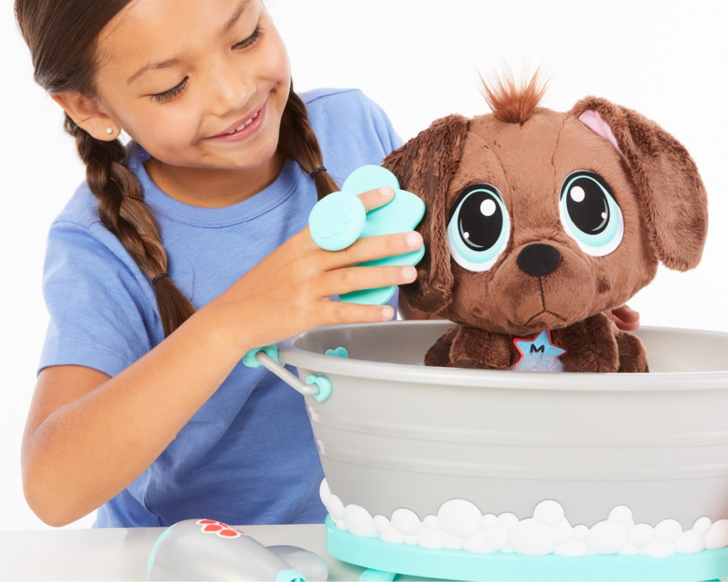little girl playing with little tikes pup bathtub