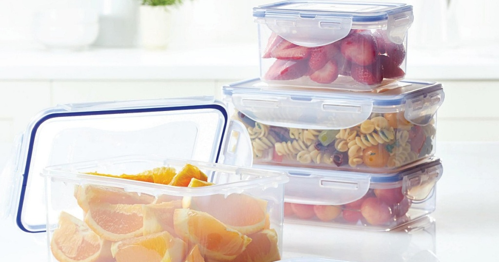 containers with fruit in them with lids on top