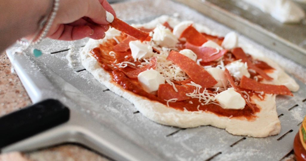making pizza on an Ooni pizza peel