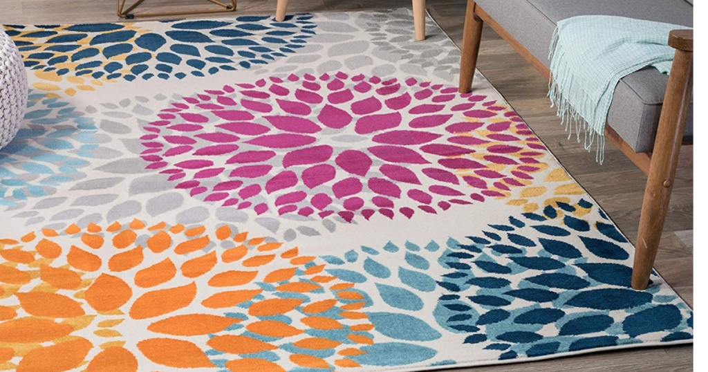 colorful area rug on wooden floor by furniture