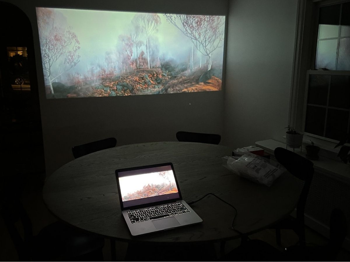 movie on laptop playing on projector screen