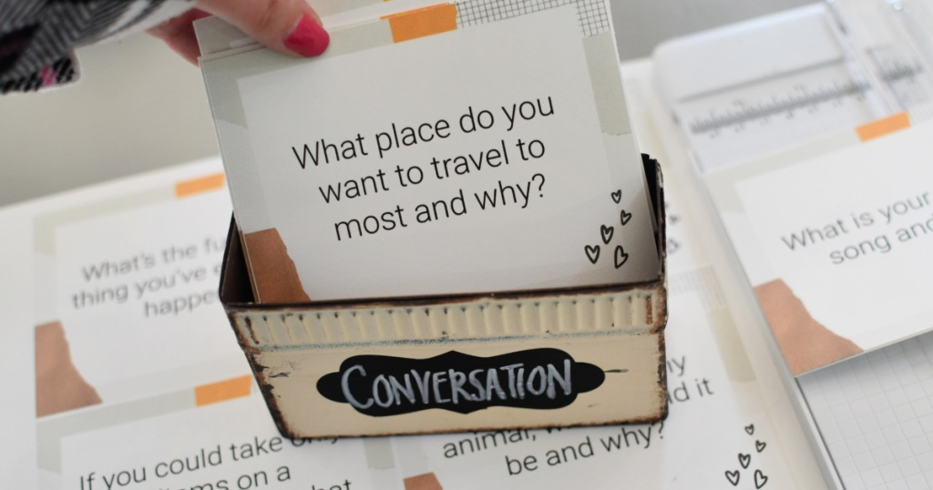 placing free printable conversation cards in a box