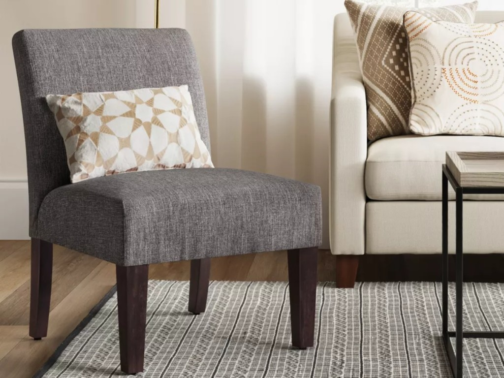 gray chair with accent pillow