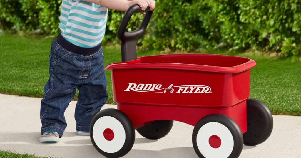 little boy pushing xradio flyer my 1st wagon