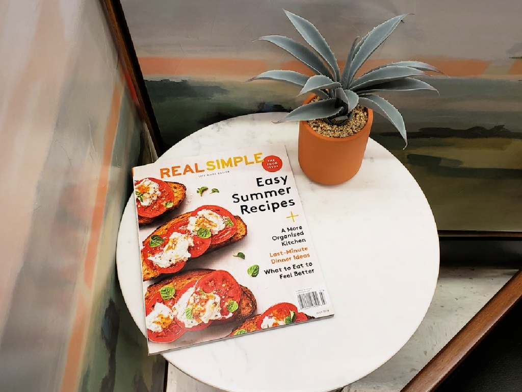 real simple magazine on table with plant