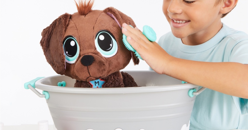 little boy playing with rescue tales bathtub